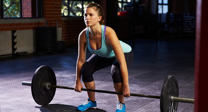 Woman In Gym Preparing To do a bent over row