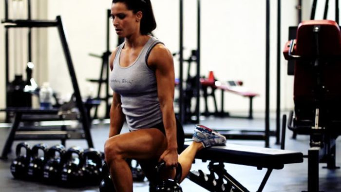 woman performing a Bulgarian split squat