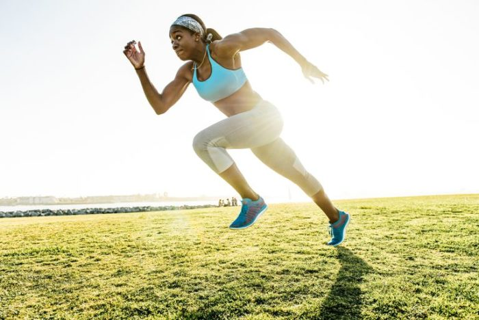 woman sprinting as part of a weight loss workout